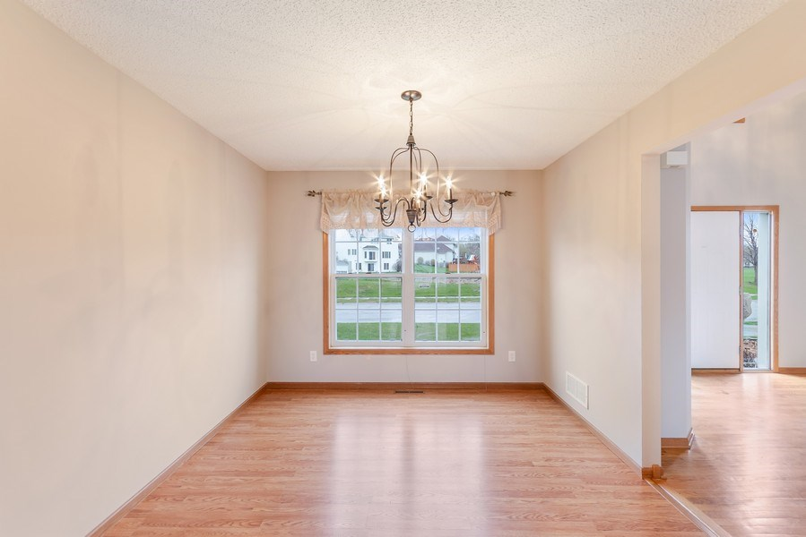 Real Estate Photography - 10686 182nd Ave NW, Elk River, MN, 55330 - Dining Room