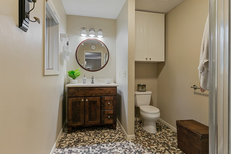 Real Estate Photography - 9217 Briar Ln, Bloomington, MN, 55437 - Stunning Master bath with beautifully tiled floors