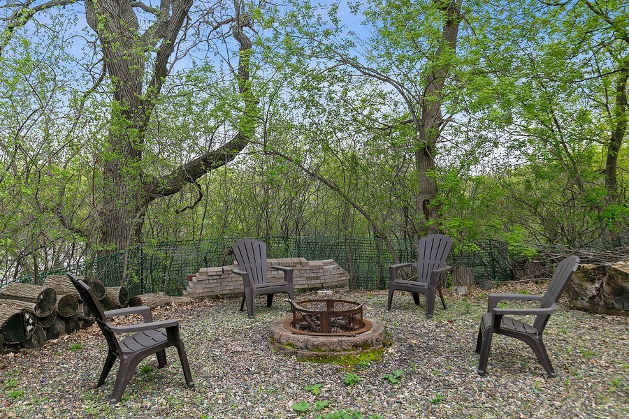 Real Estate Photography - 9217 Briar Ln, Bloomington, MN, 55437 - Beautiful back yard! Ready for s'mores!