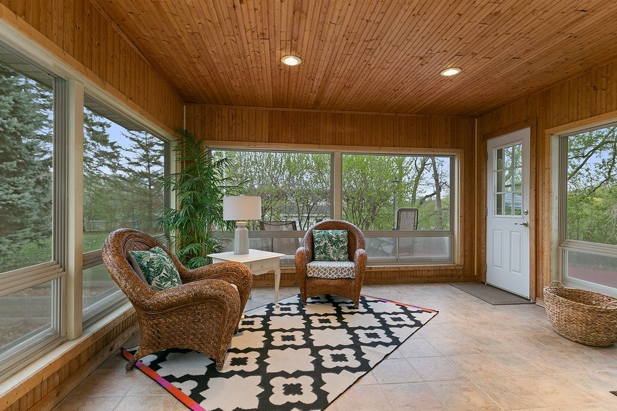 Real Estate Photography - 9217 Briar Ln, Bloomington, MN, 55437 - Beautiful sunroom for your morning coffee!