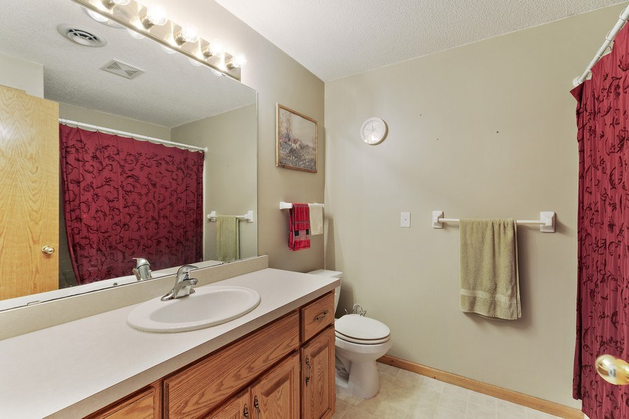 Real Estate Photography - 8761 Alamo Cir, Blaine, MN, 55449 - Bathroom