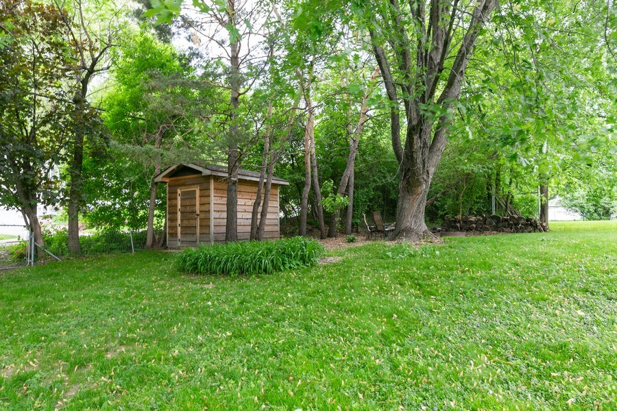 Real Estate Photography - 5302 Holiday Road, Minnetonka, MN, 55345 - Back Yard (Shed and Firepit Area)