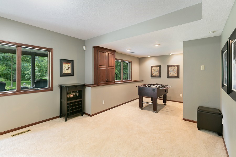 Real Estate Photography - 22861 Ridge Cir, Lakeville, MN, 55044 - Game Room Area