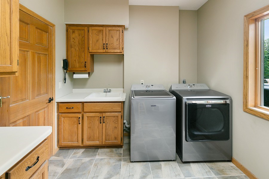 Real Estate Photography - 22861 Ridge Cir, Lakeville, MN, 55044 - Main Level Laundry