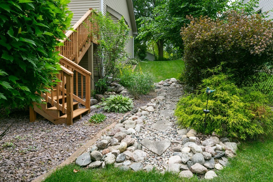 Real Estate Photography - 1430 Aretz CT, Victoria, MN, 55386 - Walkway to the backyard. One of two staircases to