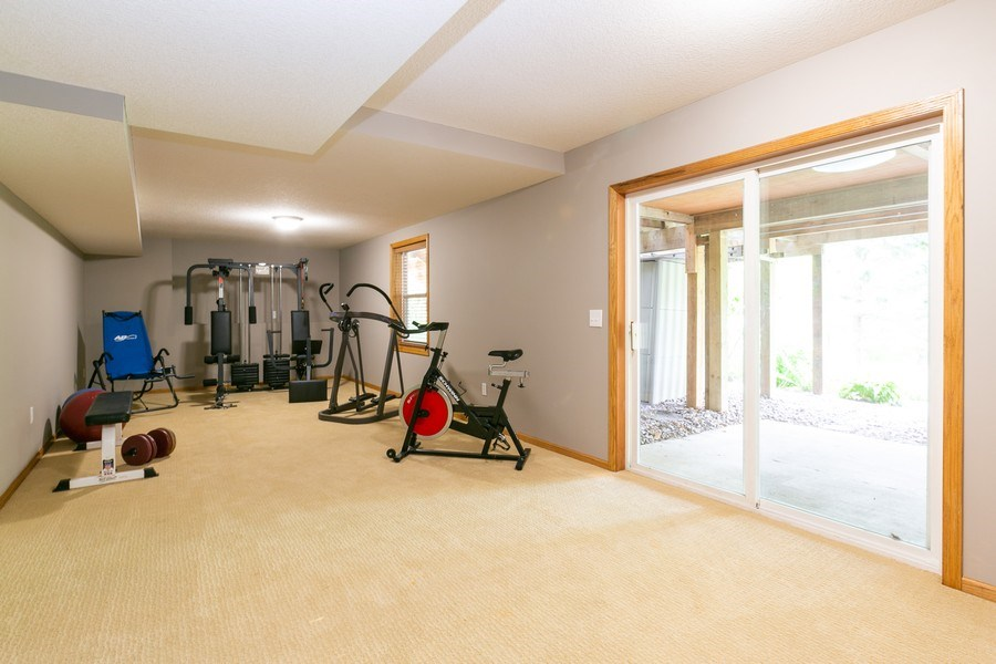 Real Estate Photography - 1430 Aretz CT, Victoria, MN, 55386 - Lower level walkout. Possible future fourth bedroo