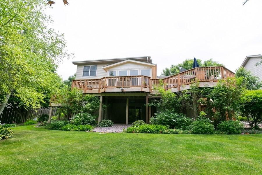 Real Estate Photography - 1430 Aretz CT, Victoria, MN, 55386 - Wraparound deck and backyard