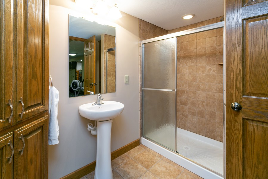 Real Estate Photography - 13311 Greenwich Ct, Apple Valley, MN, 55124 - Lower Level Bathroom