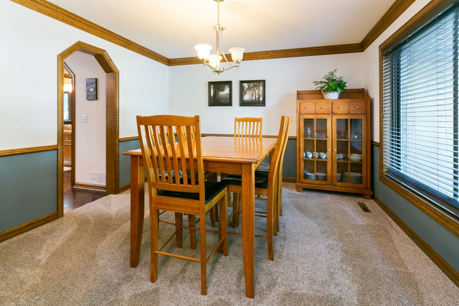 Real Estate Photography - 13311 Greenwich Ct, Apple Valley, MN, 55124 - Dining off of Kitchen