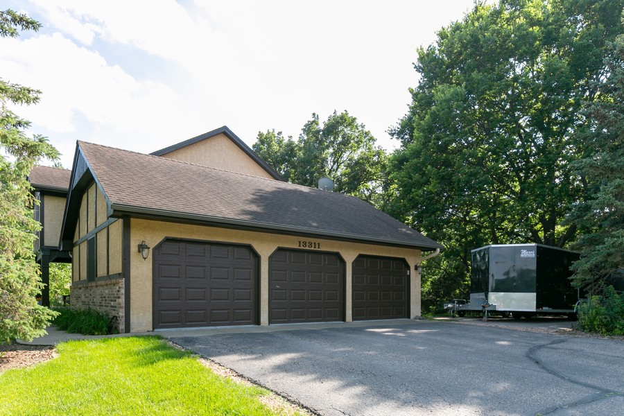 Real Estate Photography - 13311 Greenwich Ct, Apple Valley, MN, 55124 - Side load Garage with extra parking pad