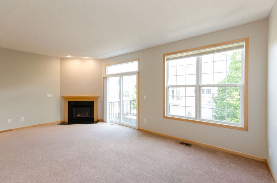 Real Estate Photography - 5124 Scott Path, Robbinsdale, MN, 55422 - Living Room