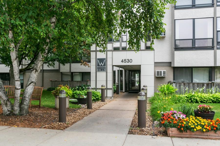 Real Estate Photography - 4530 Park Commons Dr, Unit 320, St Louis Park, MN, 55416 - Front View