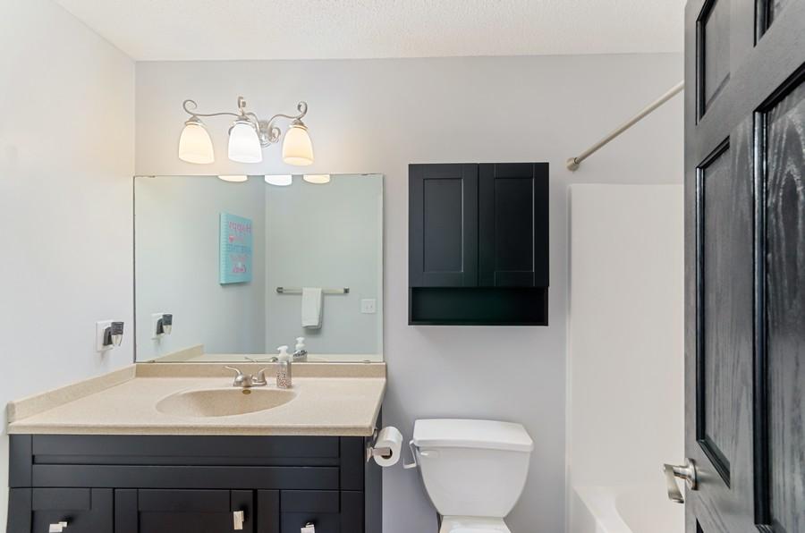 Real Estate Photography - 12494 Davenport Street NE, Blaine, MN, 55449 - Bathroom