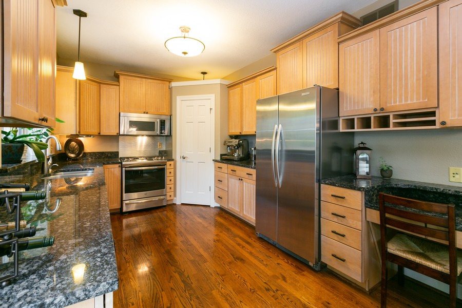 Real Estate Photography - 18978 Embry Ave, Farmington, MN, 55124 - Kitchen