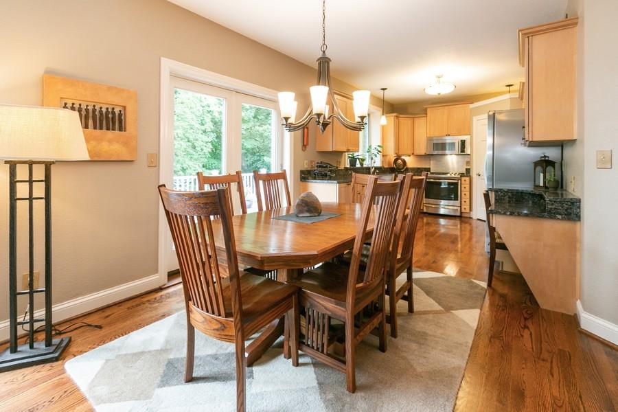 Real Estate Photography - 18978 Embry Ave, Farmington, MN, 55124 - Informal Dining Room