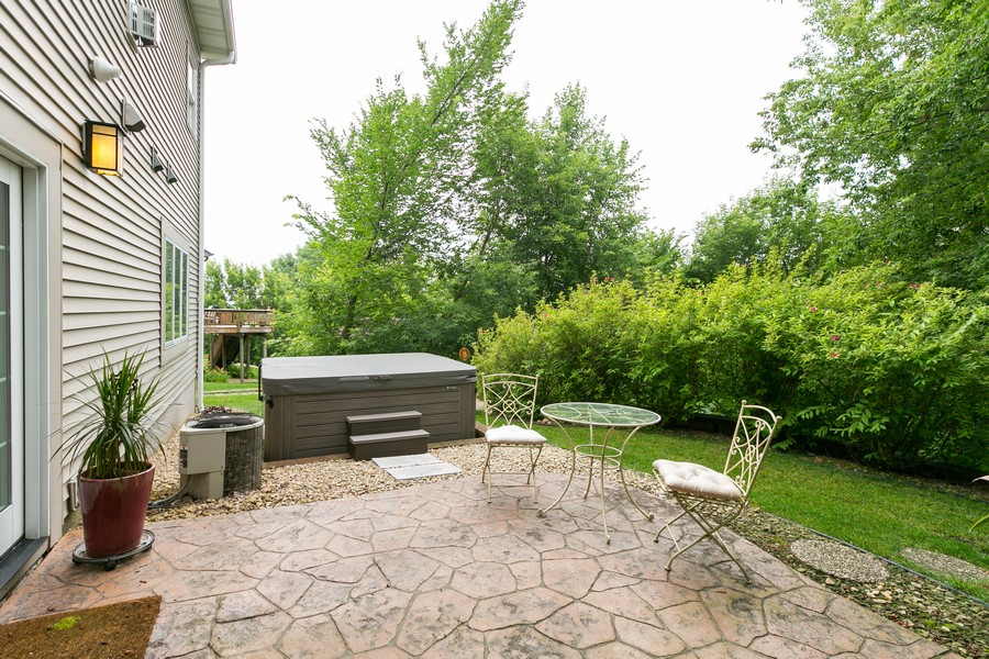 Real Estate Photography - 18978 Embry Ave, Farmington, MN, 55124 - Stamped Concrete Patio and Hot Tub
