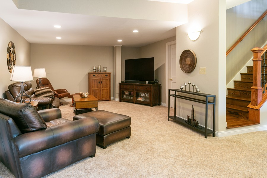 Real Estate Photography - 18978 Embry Ave, Farmington, MN, 55124 - Lower Level Family Room