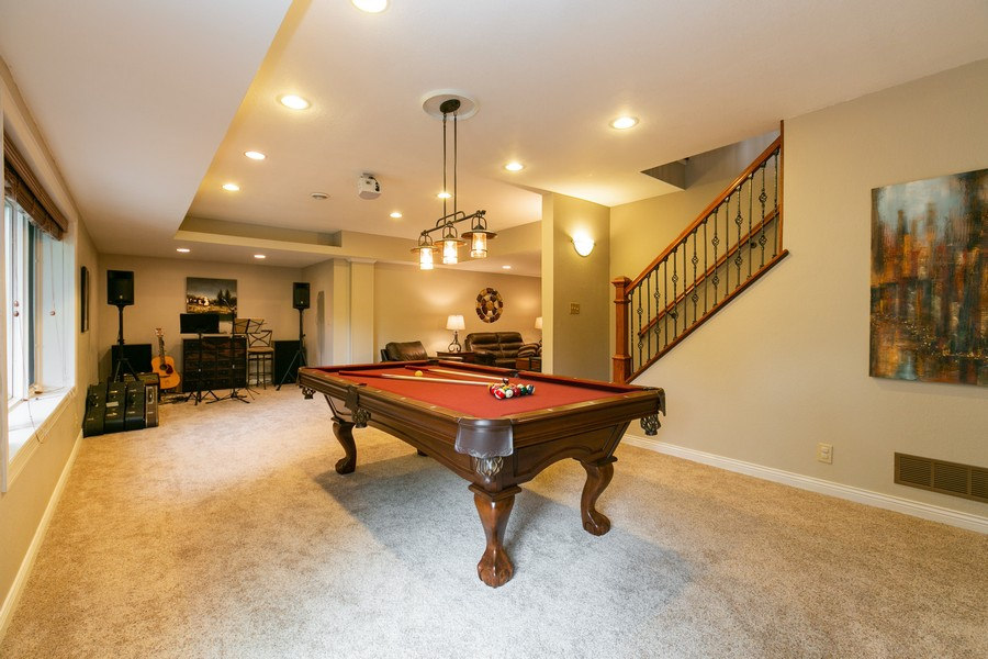 Real Estate Photography - 18978 Embry Ave, Farmington, MN, 55124 - Lower Level Amusement Room