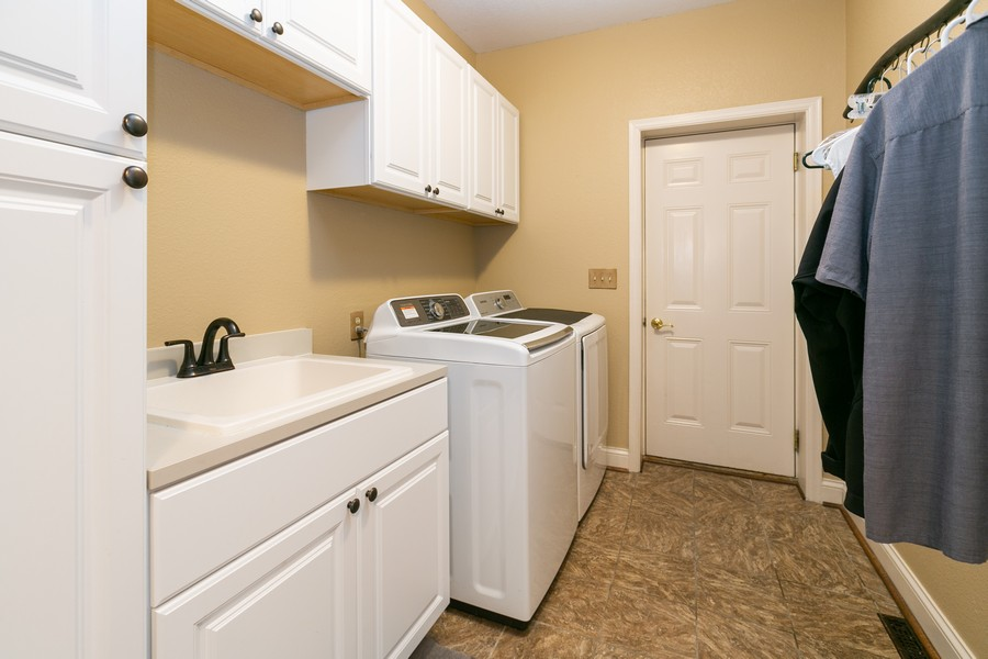 Real Estate Photography - 18978 Embry Ave, Farmington, MN, 55124 - Main Level Laundry Room