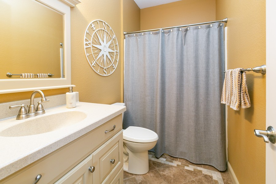 Real Estate Photography - 18978 Embry Ave, Farmington, MN, 55124 - Main Level Bathroom
