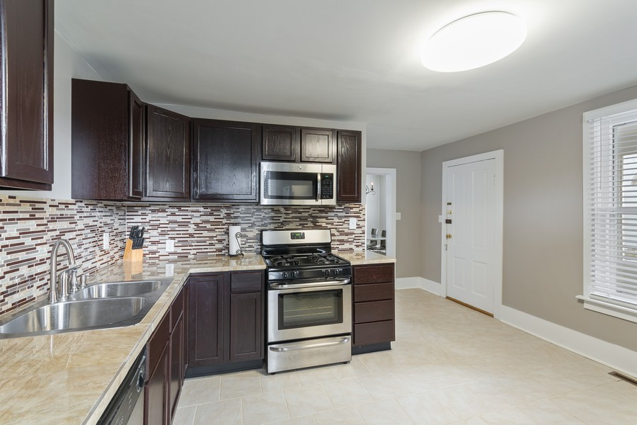 Real Estate Photography - 1350 Charles Ave, St. Paul, MN, 55104 - Kitchen
