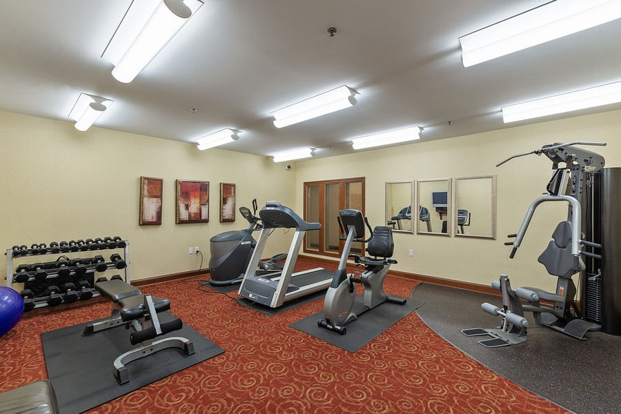 Real Estate Photography - 408 Parkers Lake Rd, Unit 201, Minnetonka, MN, 55391 - Exercise Room