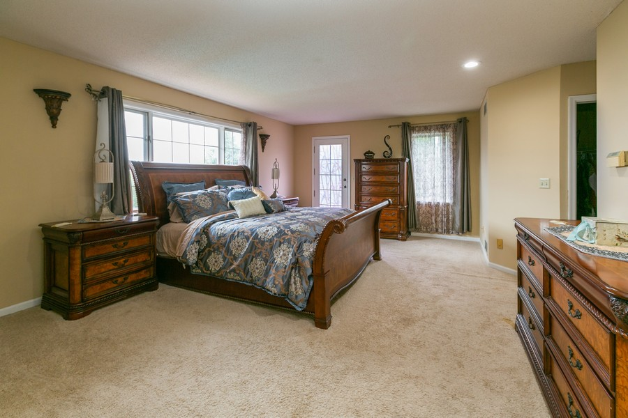 Real Estate Photography - 9046 Edinburgh Ln, Woodbury, MN, 55125 - Master Bedroom