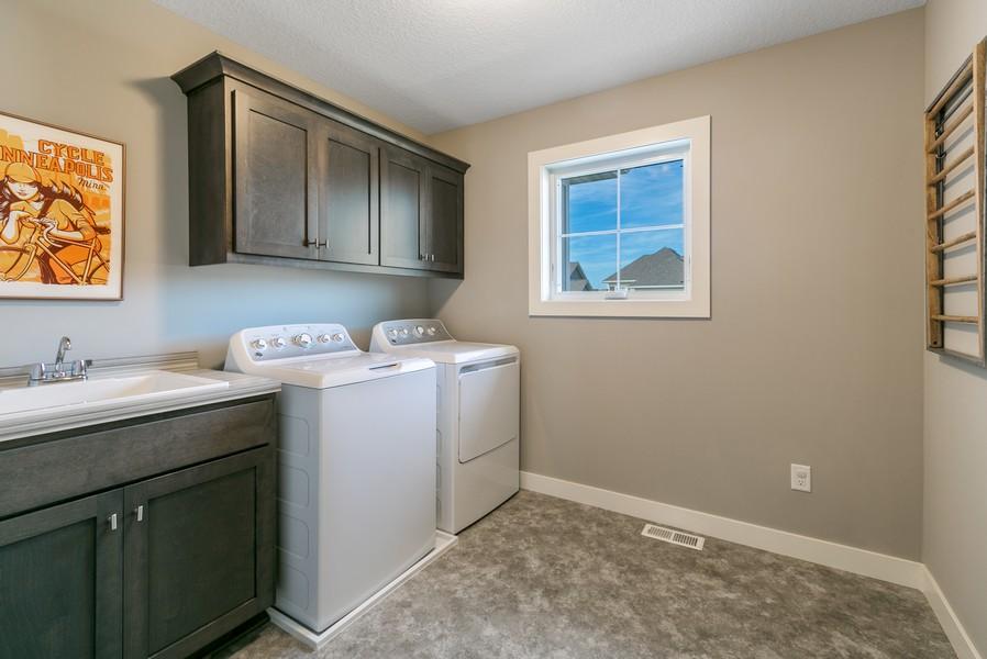 Real Estate Photography - 16219 Elkhorn Trail, Lakeville, MN, 55044 - Upper level Laundry room