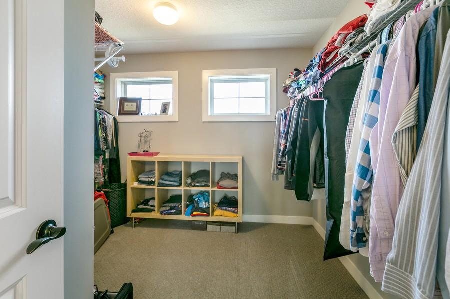 Real Estate Photography - 16219 Elkhorn Trail, Lakeville, MN, 55044 - Master bedroom walk-in closet