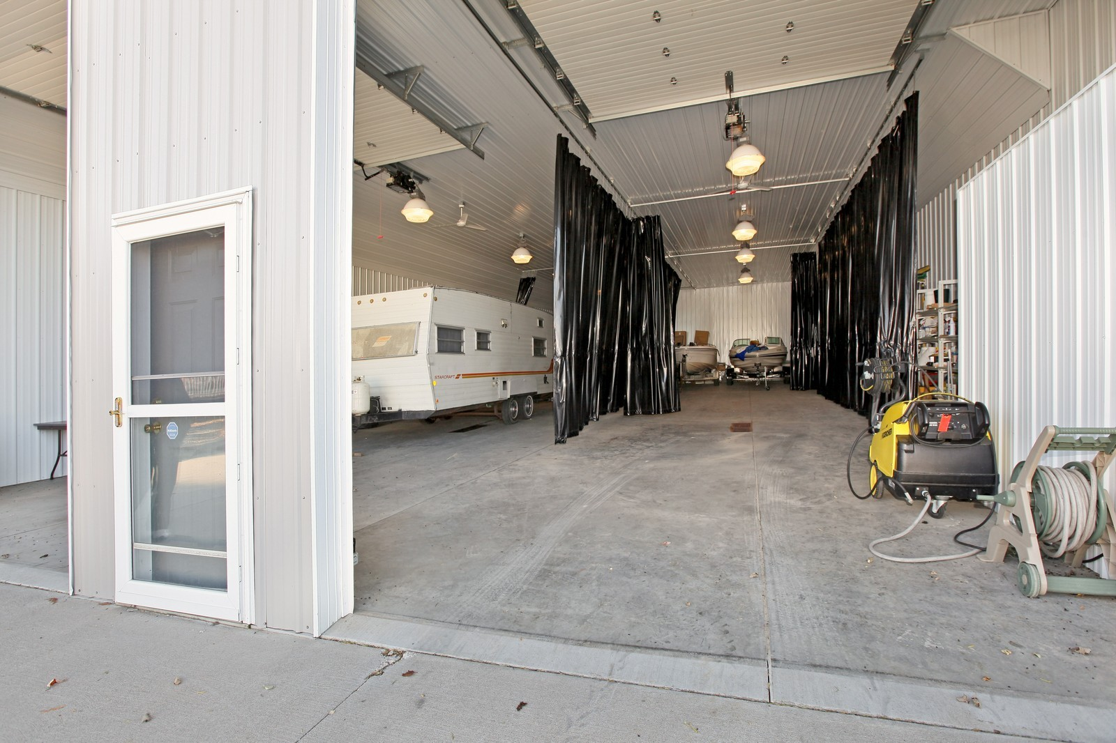 Real Estate Photography - 8095 Trail Haven Rd, Corcoran, MN, 55340 - Garage