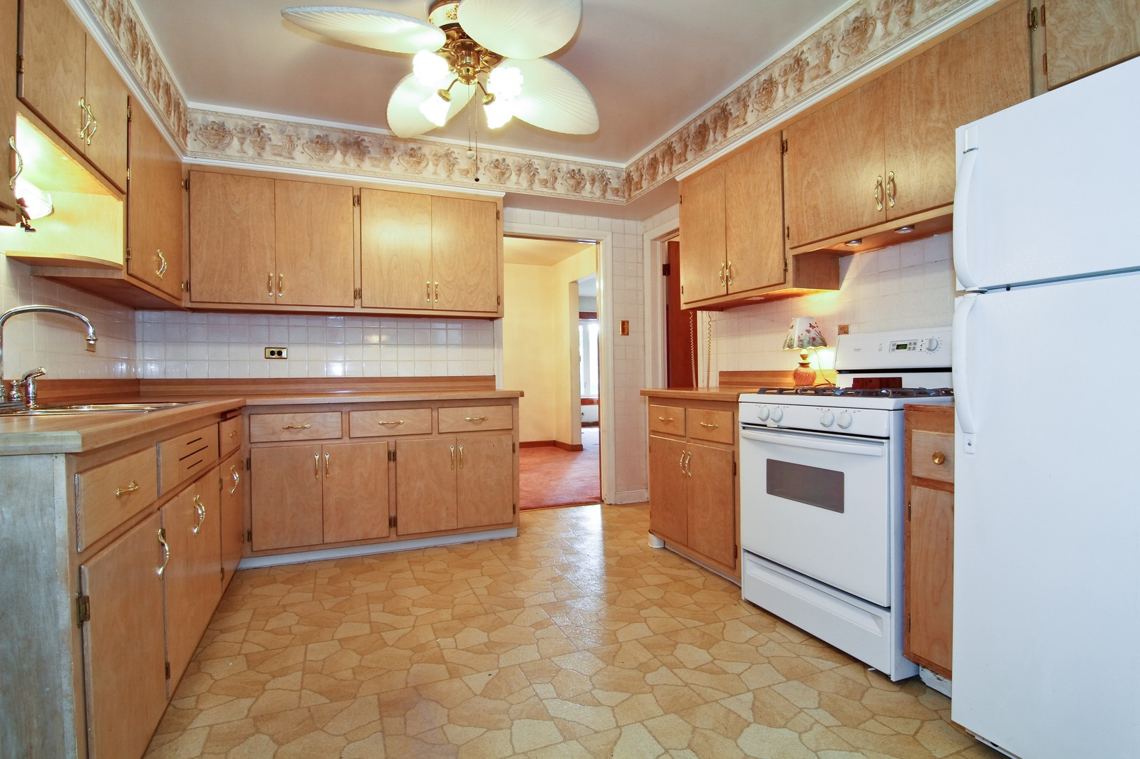 Real Estate Photography - 1300 Balmoral, Westchester, IL, 60154 - Kitchen