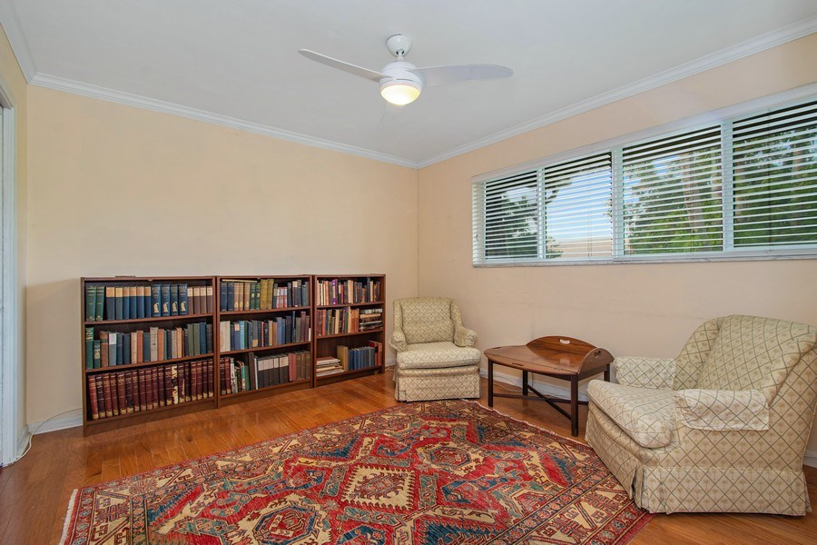 Real Estate Photography - 2860 NE 55th PL, Fort Lauderdale, FL, 33308 - Ensuite Bedroom Used as a Library