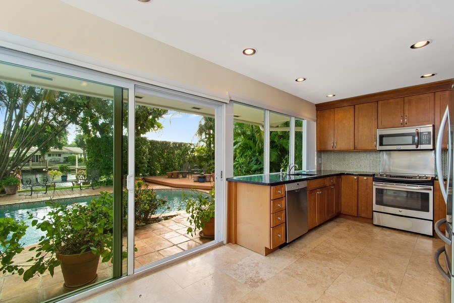 Real Estate Photography - 2860 NE 55th PL, Fort Lauderdale, FL, 33308 - Eat-In Kitchen with Waterfront View