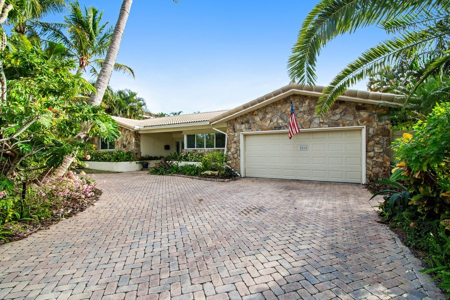 Real Estate Photography - 2860 NE 55th PL, Fort Lauderdale, FL, 33308 - Front Exterior, Circular Drive, Double Garage