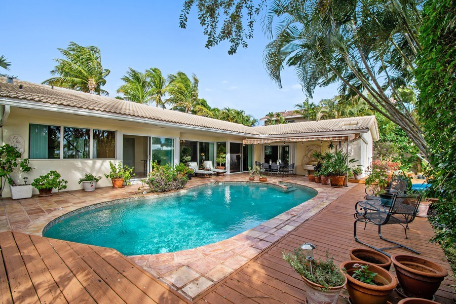 Real Estate Photography - 2860 NE 55th PL, Fort Lauderdale, FL, 33308 - Back Exterior View and Heated Pool