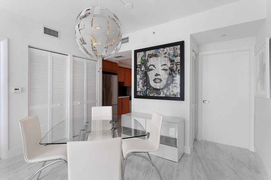 Real Estate Photography - 6365 Collins Avenue 2704, Miami Beach, FL, 33141 - Dining Room