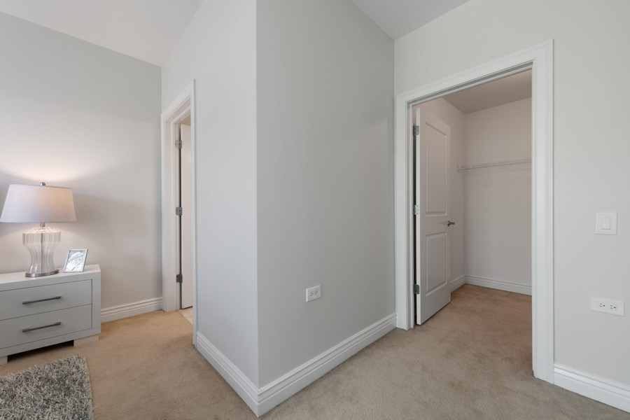 Real Estate Photography - 3300 W Irving Park Rd, Unit 3H, Chicago, IL, 60618 - Master Bedroom Closet
