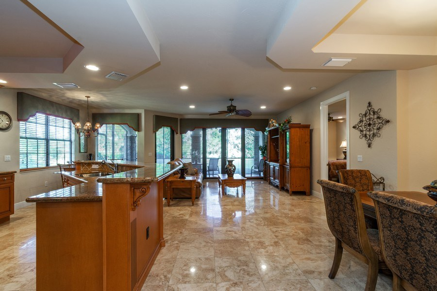 Real Estate Photography - 7601 Old Thyme Ct, Parkland, FL, 33076 - Kitchen / Living Room