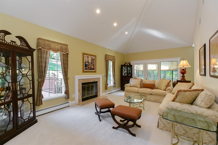 Real Estate Photography - 5 Elizabeth Ct, Briarcliff Manor, NY, 10510 - Sunken Living Room with Double-height Ceilings