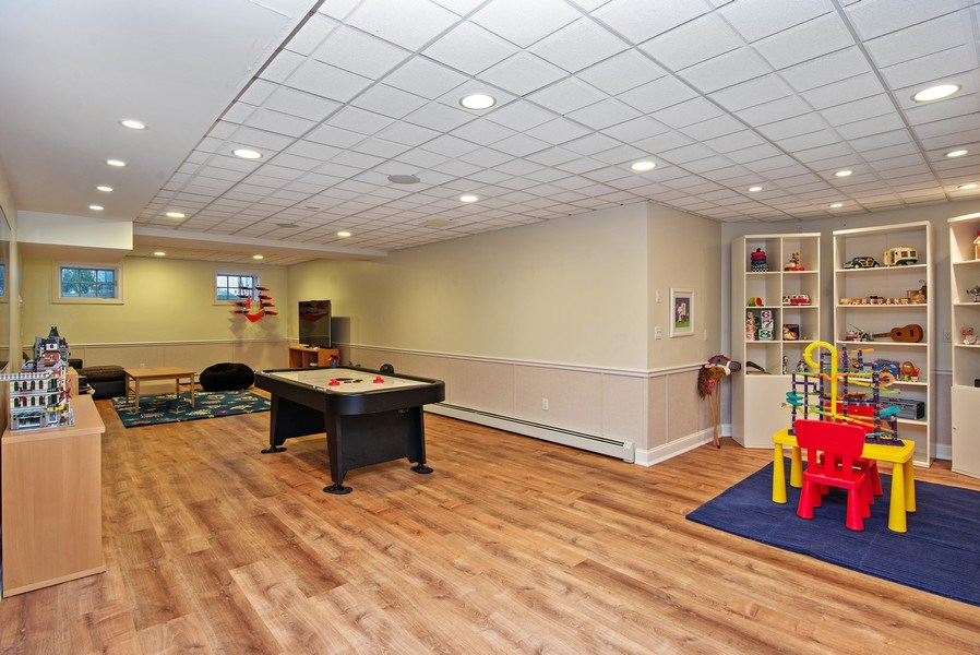 Real Estate Photography - 202 Hirst Rd, Briarcliff Manor, NY, 10510 - Huge Lower Level Playroom w/back staircase