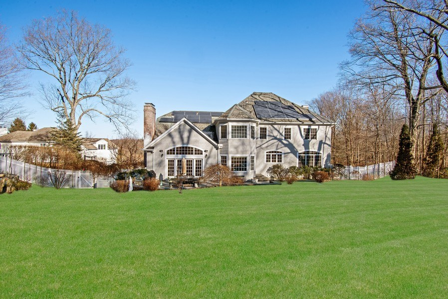 Real Estate Photography - 202 Hirst Rd, Briarcliff Manor, NY, 10510 - Rear view of home and fenced-in backyard