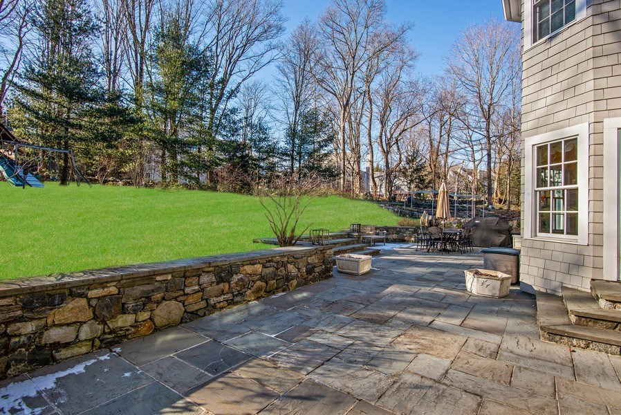 Real Estate Photography - 202 Hirst Rd, Briarcliff Manor, NY, 10510 - Alternate view of Patio w/stone walls & backyard