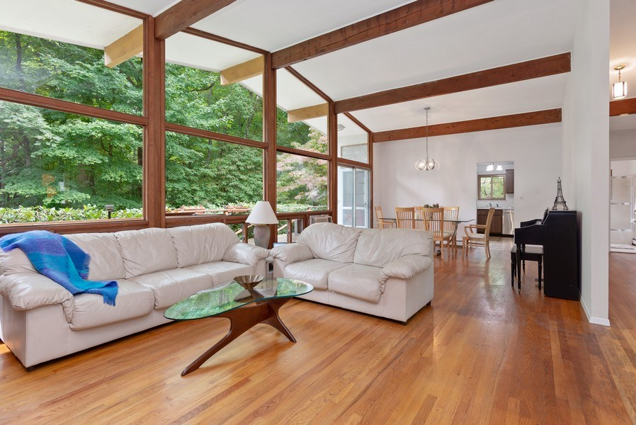 Real Estate Photography - 3 Morningside Ct, Ossining, NY, 10562 - Full view of LR & DR w/wall of windows/beams