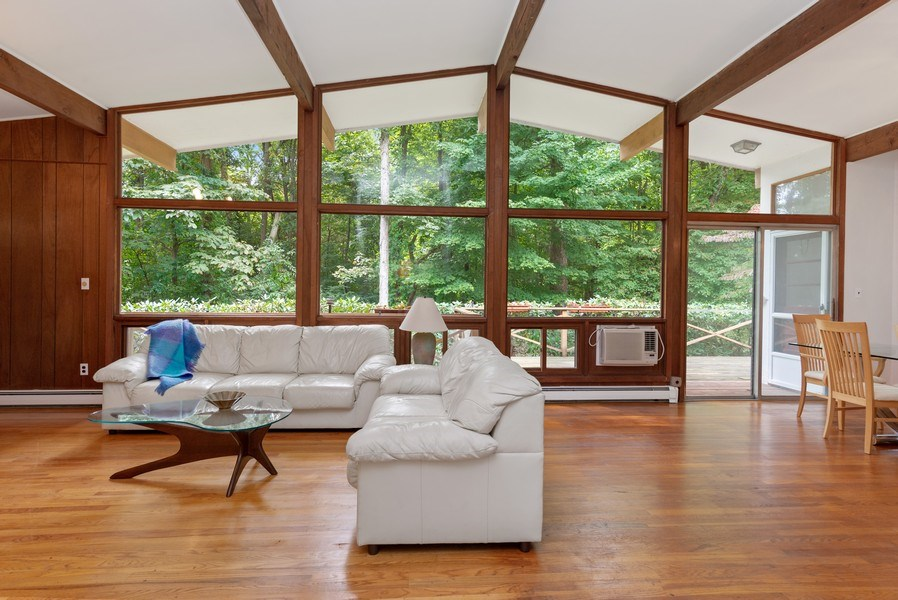 Real Estate Photography - 3 Morningside Ct, Ossining, NY, 10562 - Dramatic view of Wall of Windows in LR/DR