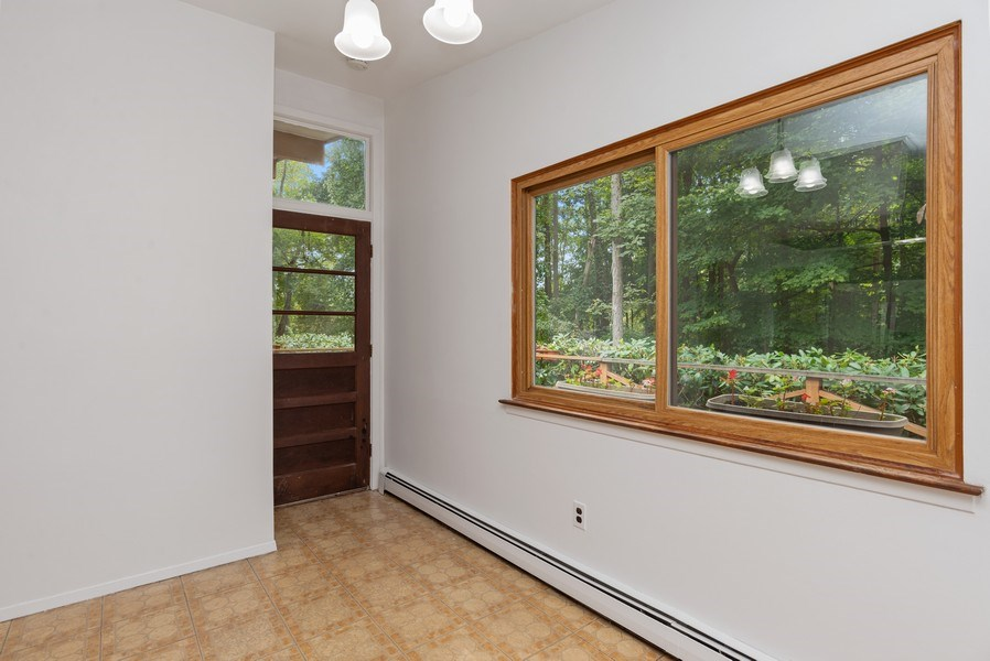 Real Estate Photography - 3 Morningside Ct, Ossining, NY, 10562 - Sunlit Breakfast Area of EIK w/Door to Deck