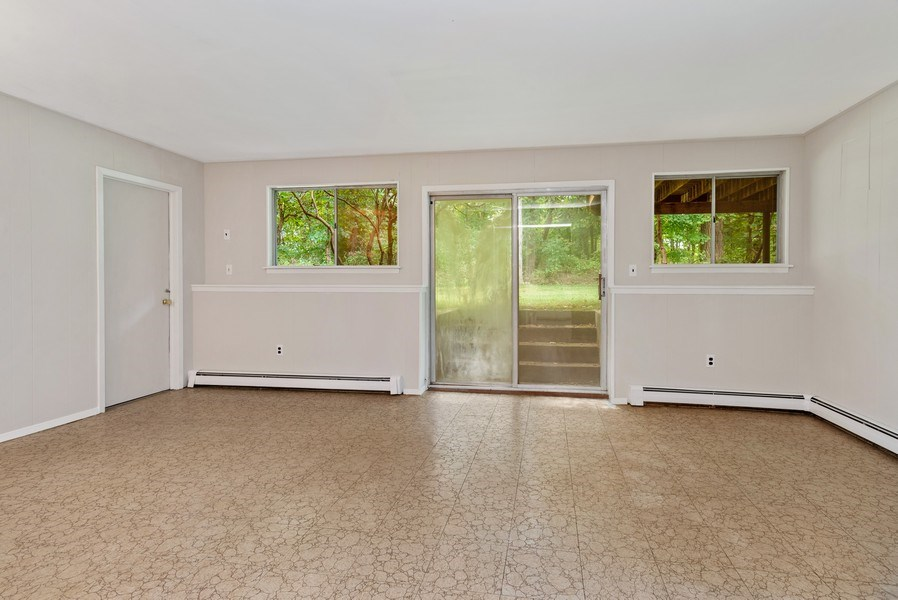 Real Estate Photography - 3 Morningside Ct, Ossining, NY, 10562 - Large Family/Play Room with SGD to rear Yard