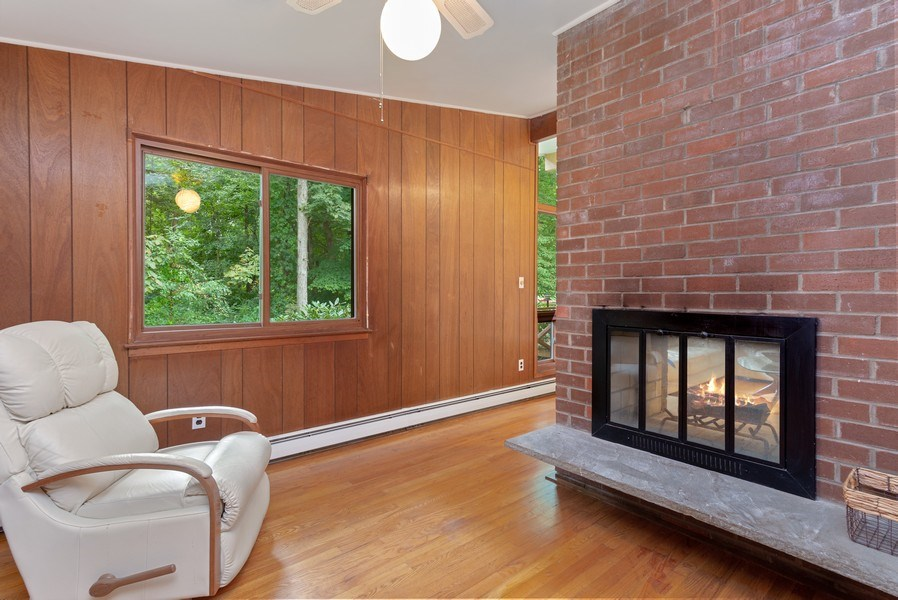 Real Estate Photography - 3 Morningside Ct, Ossining, NY, 10562 - Den Area on main floor with Dual-Sided FPL
