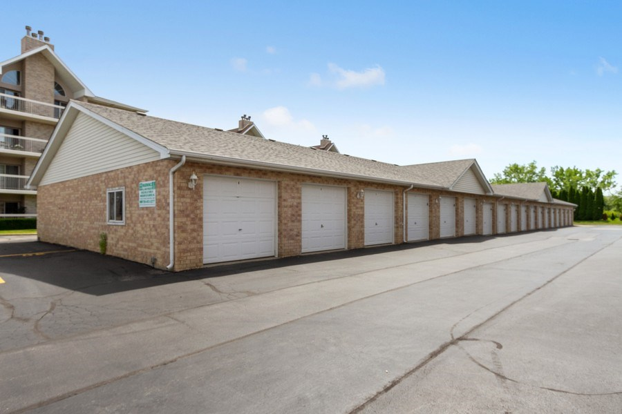 Real Estate Photography - 7775 Bristol Park Dr, Unit 3NW, Tinley Park, IL, 60477 - Garage