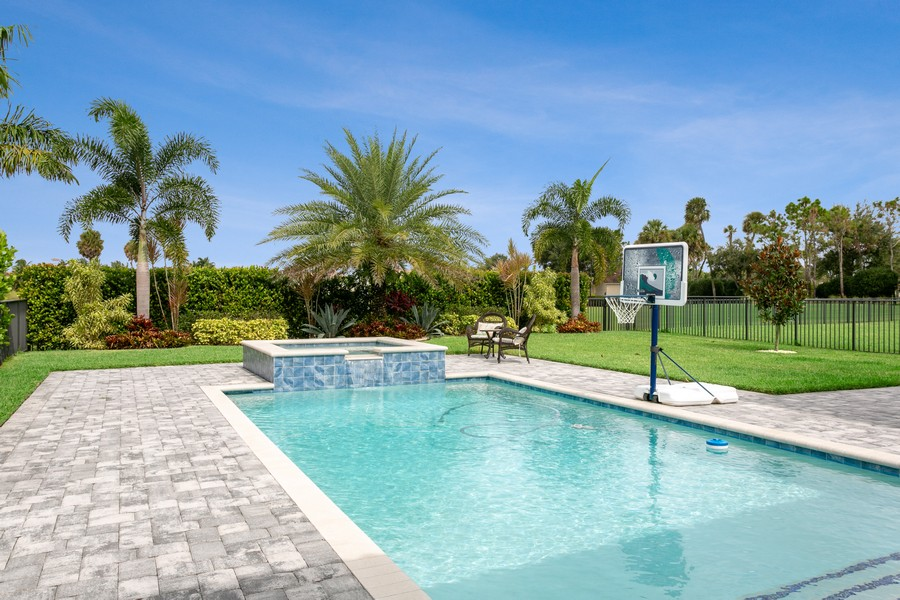 Real Estate Photography - 111 Lucia Ct, Jupiter, FL, 33478 - Pool and Spa back yard