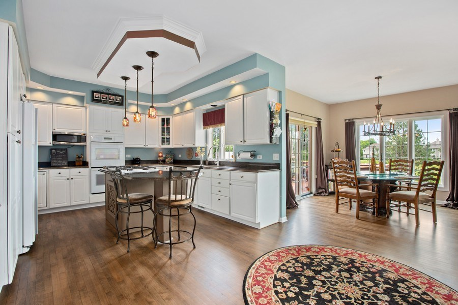 Real Estate Photography - 1063 Sandstone Court, Aurora, IL, 60502 - Kitchen with Breakfast Bar Island